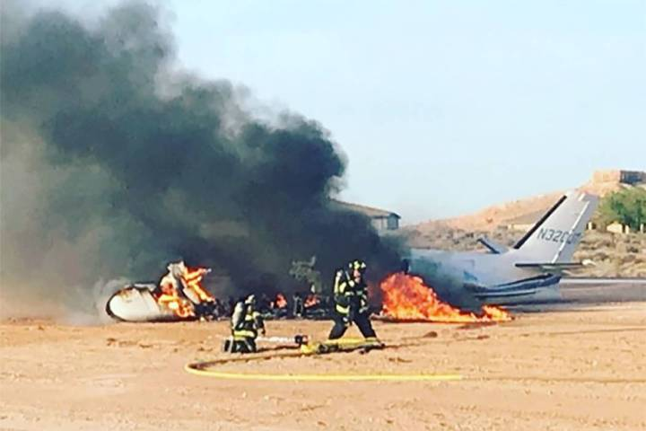 Firefighters work at the scene of a plane crash at Mesquite Municipal Airport on Wednesday, Jul ...