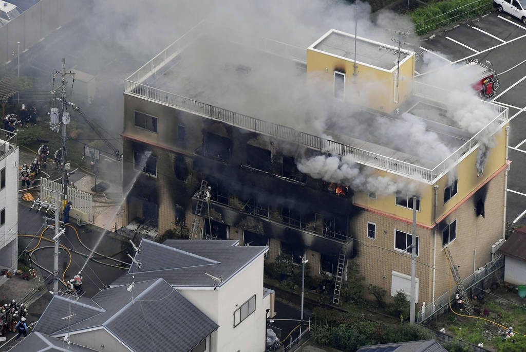 Smoke billows from a three-story building of Kyoto Animation in a fire in Kyoto, western Japan, ...