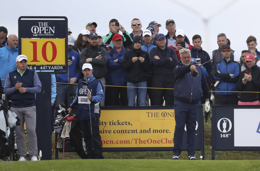 Northern Ireland's Darren Clarke points with this club as he stand on the 10th tee during the f ...