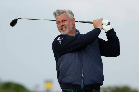 Northern Ireland's Darren Clarke tees of the 4th hole during the first round of the British Ope ...
