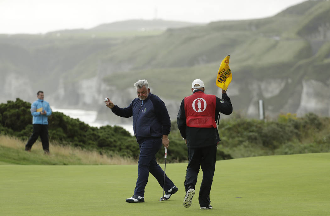 Northern Ireland's Darren Clarke acknowledges the crowd after getting a birdie on the 5th green ...