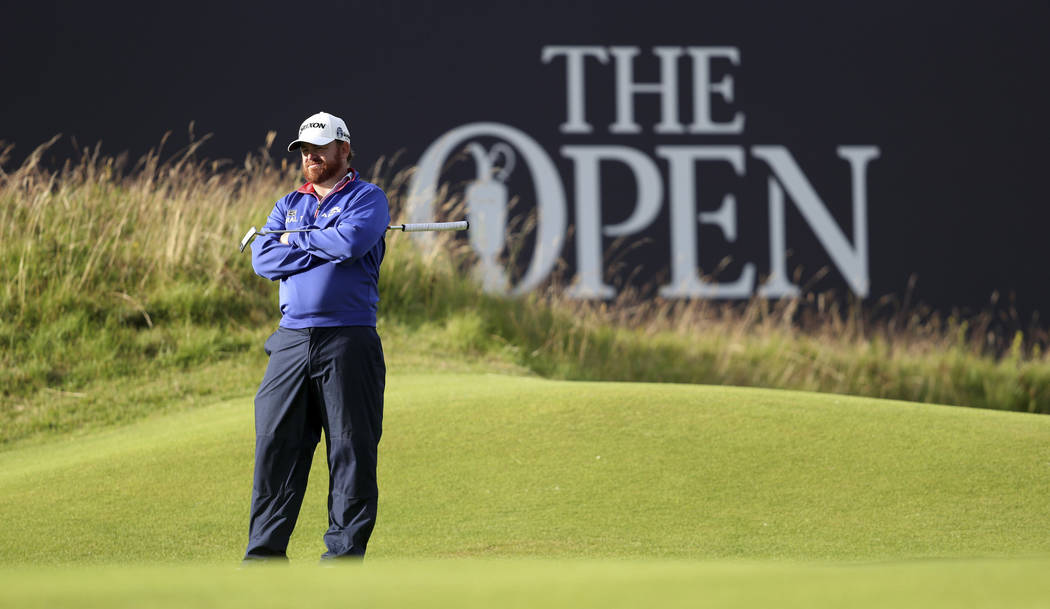 JB Holmes of the US plays on the 18th hole during the first round of the British Open Golf Cham ...