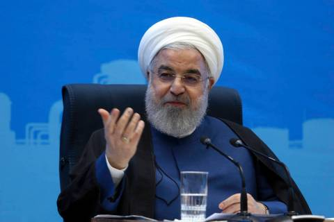 In this photo released by the official website of the office of the Iranian Presidency, Preside ...