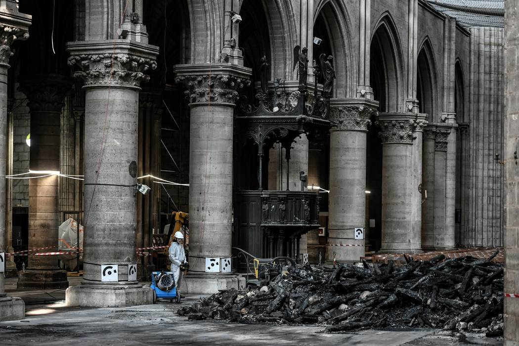 Workers are pictured during preliminary work at the Notre-Dame de Paris Cathedral, Wednesday, J ...