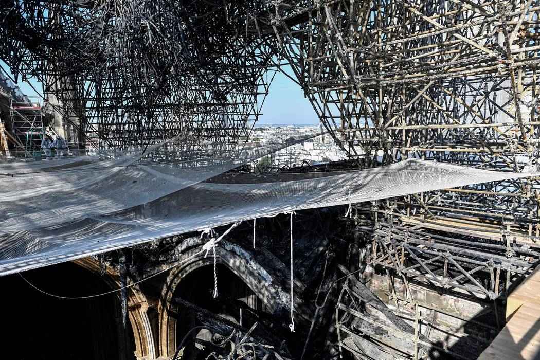 Parts of a destroyed ribbed vault and scaffolding are pictured at the Notre-Dame de Paris Cathe ...