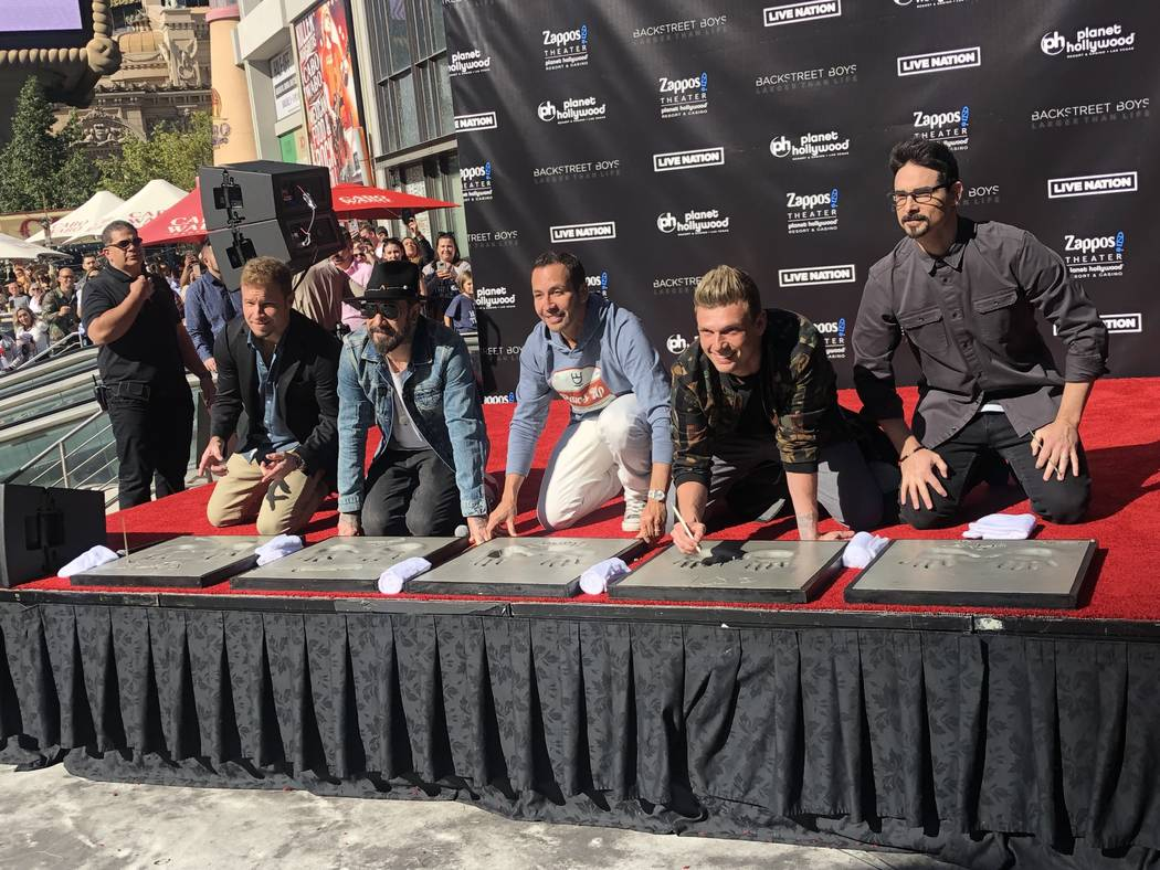 The Backstreet Boys are shown during their hand-print ceremony at Planet Hollywood on Friday, A ...