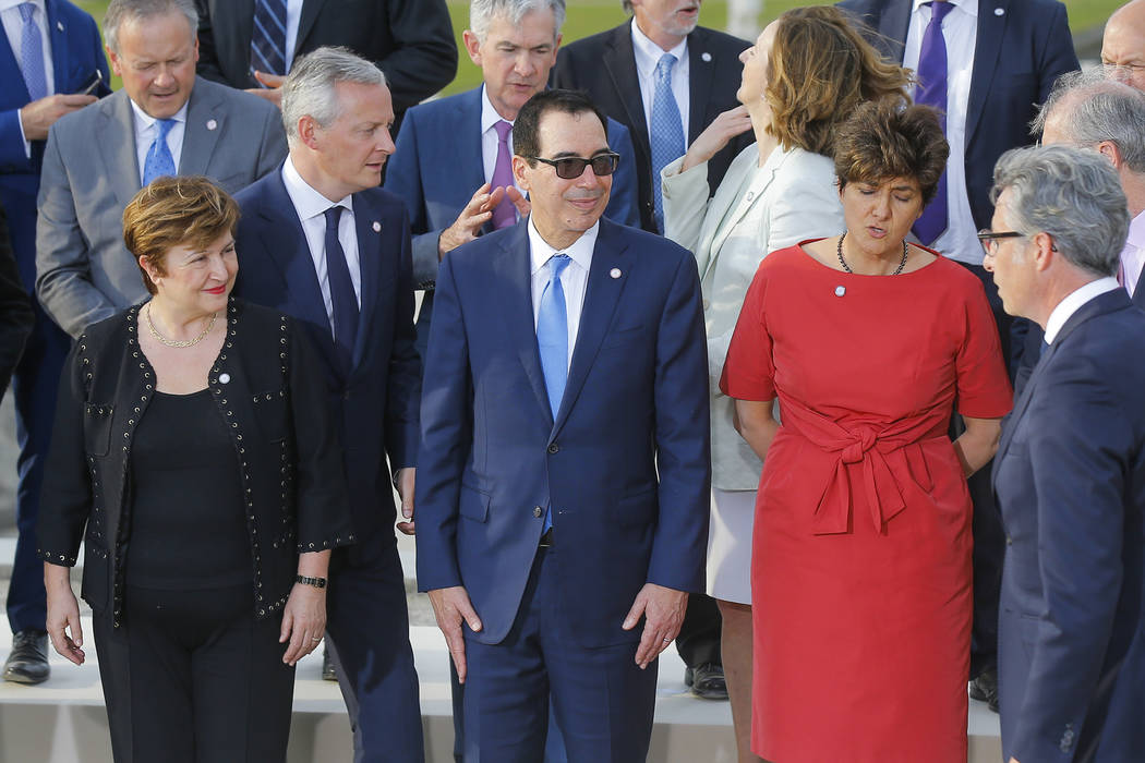 US Treasury Secretary Steve Mnuchin, front center, stands next to Chief Executive of the World ...