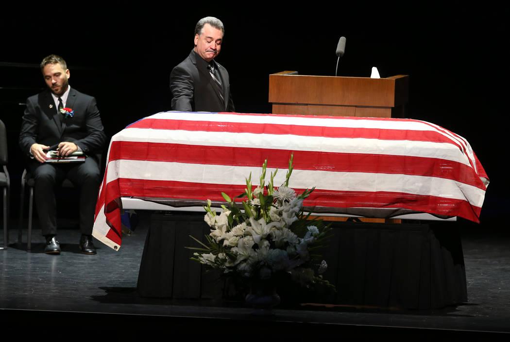 Friend Dennis Flynn after speaking during funeral services for former Metropolitan Police Depar ...
