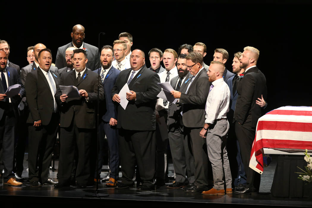 """Sons, brothers-in-law and nephews sing """"Warriors of Light"""" during funeral services fo ..."""