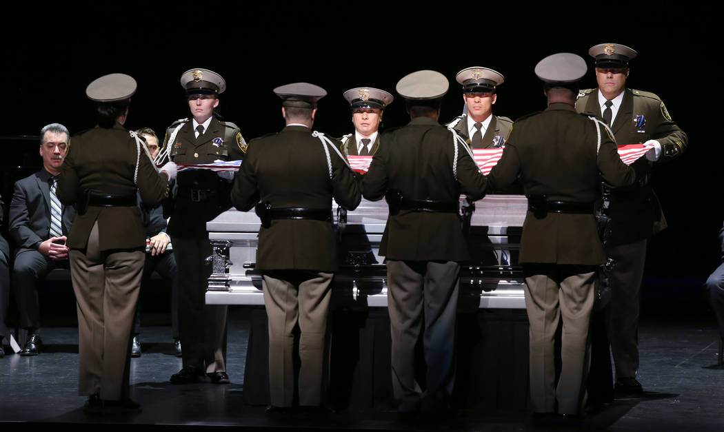 Las Vegas police honor guard prepare the flag during funeral services for former Metropolitan P ...