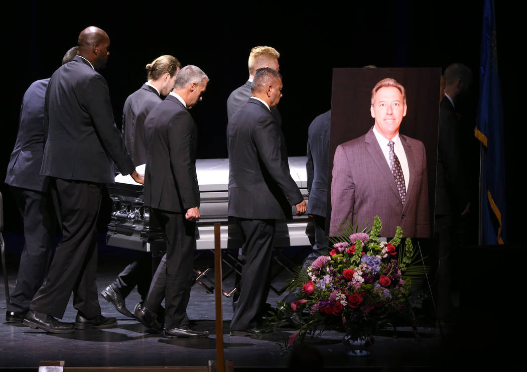 Pallbearers move the casket during funeral services for former Metropolitan Police Department C ...