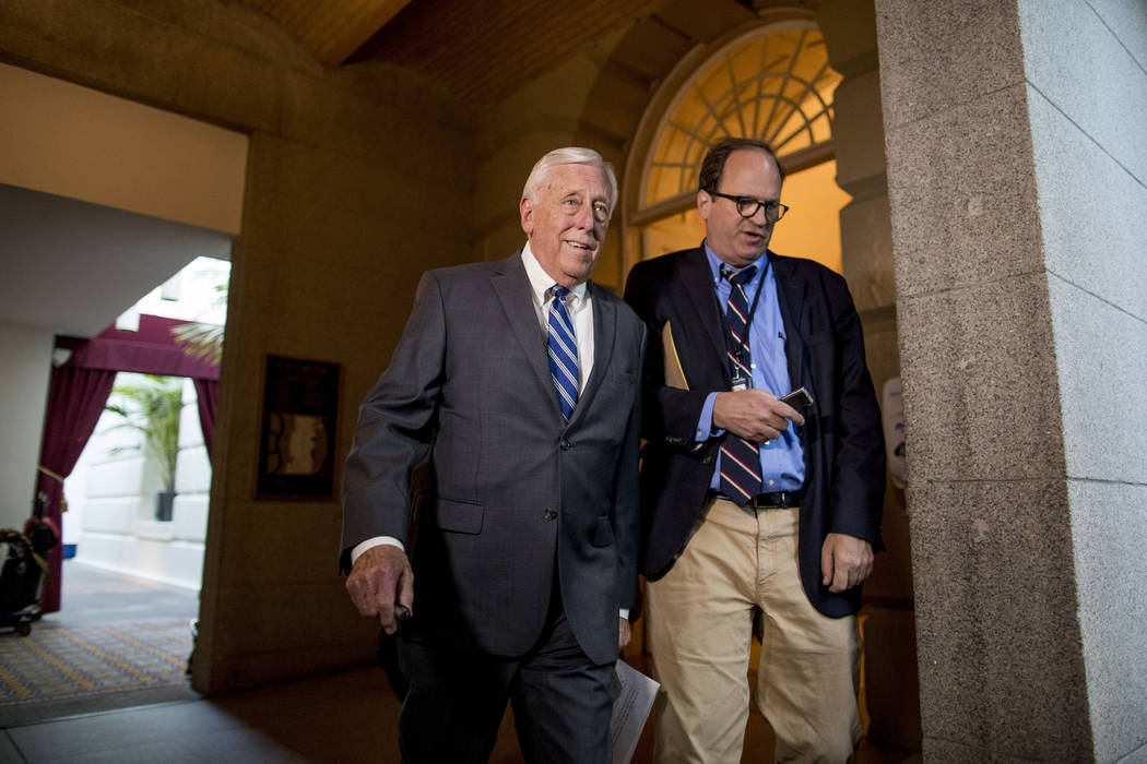 House Majority Leader Steny Hoyer of Md., left, arrives for a House Democratic caucus meeting o ...
