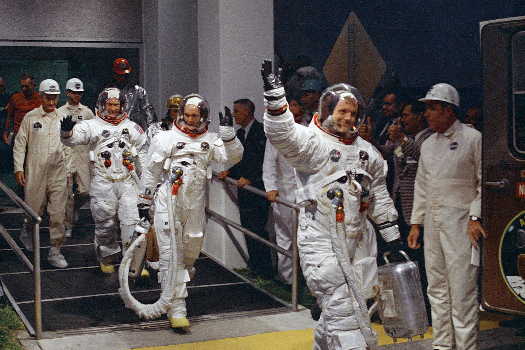 FILE - In this July 16, 1969 file photo, from right, Neil Armstrong, Michael Collins and Buzz A ...