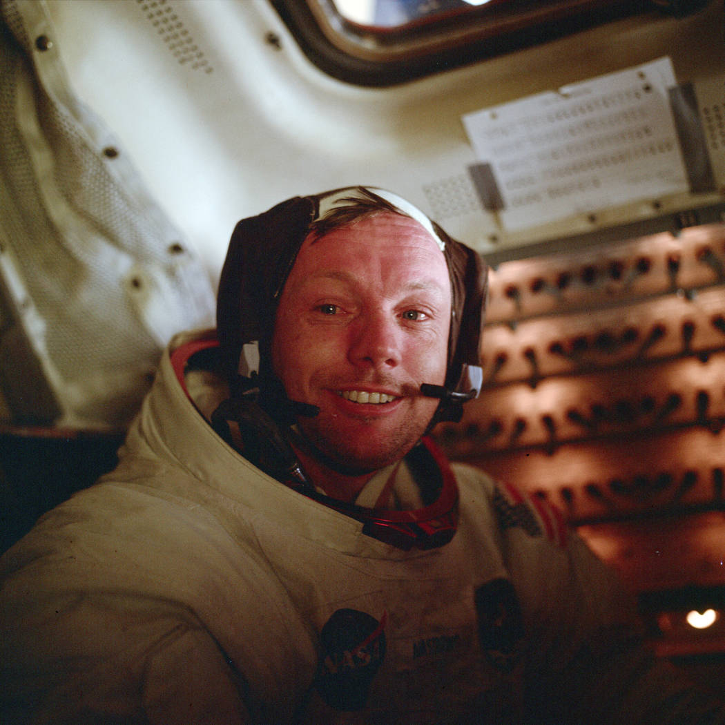 Astronaut Neil Armstrong, Apollo 11 commander, sits inside the Lunar Module after he and Buzz A ...