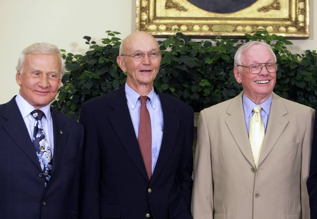 Apollo 11 astronauts, from left, Buzz Aldrin, Michael Collins and Neil Armstrong stand in the O ...