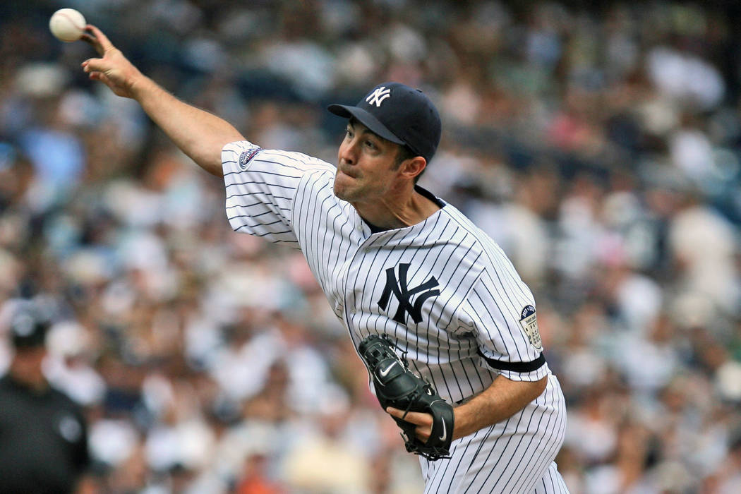 New York Yankees' Mike Mussina pitches during the sixth inning of a baseball game against the K ...