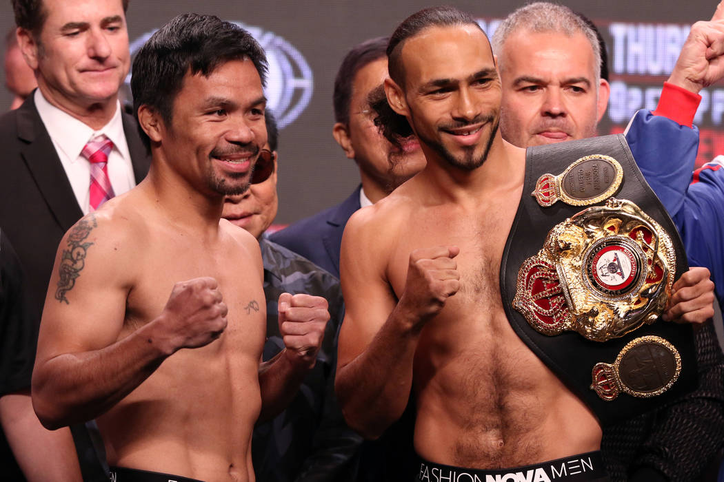 Manny Pacquiao, left, squares off with Keith Thurman during the official weigh-in at the MGM Gr ...