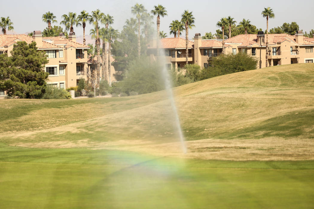Sprinklers water the lawn at Legacy Golf Club in Henderson, Thursday, Oct. 12, 2017. (Las Vegas ...