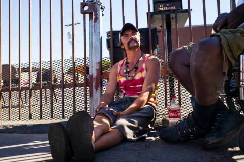 John Bell talks about living homeless while waiting in line for food on Foremaster Lane near do ...