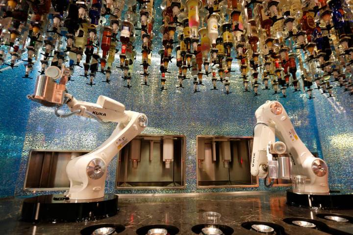 Robots demonstrate to make drinks at Tipsy Robot in the Miracle Mile Shops in Las Vegas, Monday ...