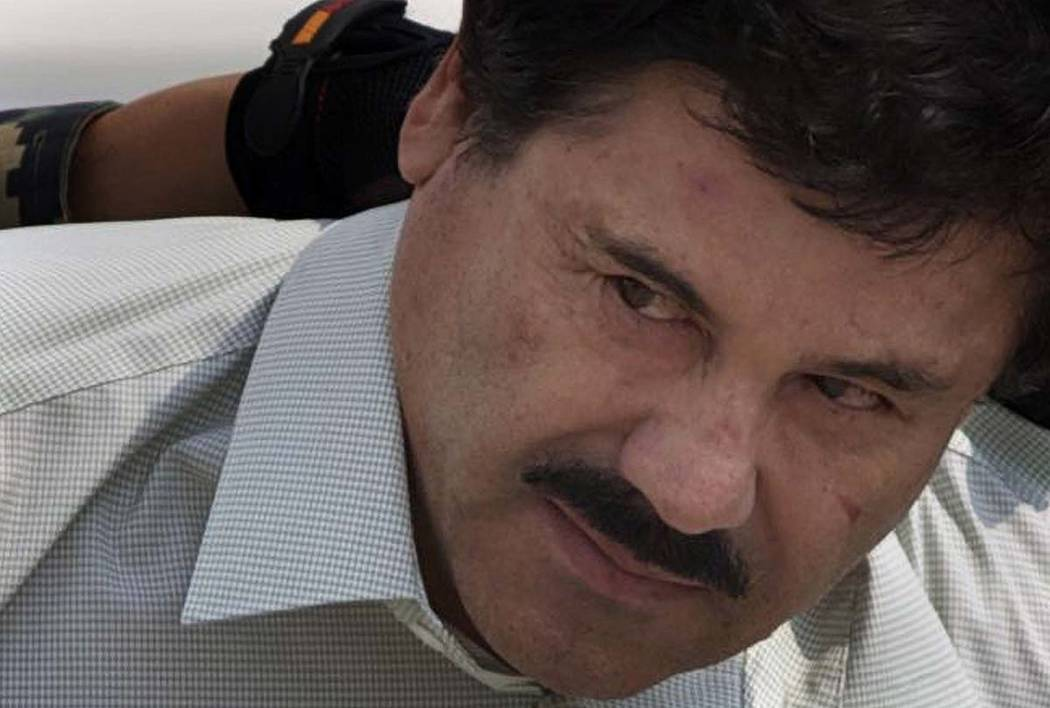 "In a Feb. 22, 2014, file photo, Joaquin ""El Chapo"" Guzman is escorted to a helicopter in handcu ..."