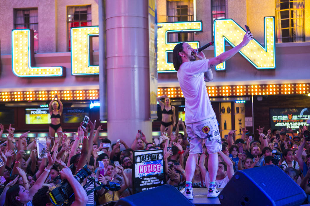 Steve Aoki performs on the Main Street Stage at the Fremont Street Experience after the debut o ...