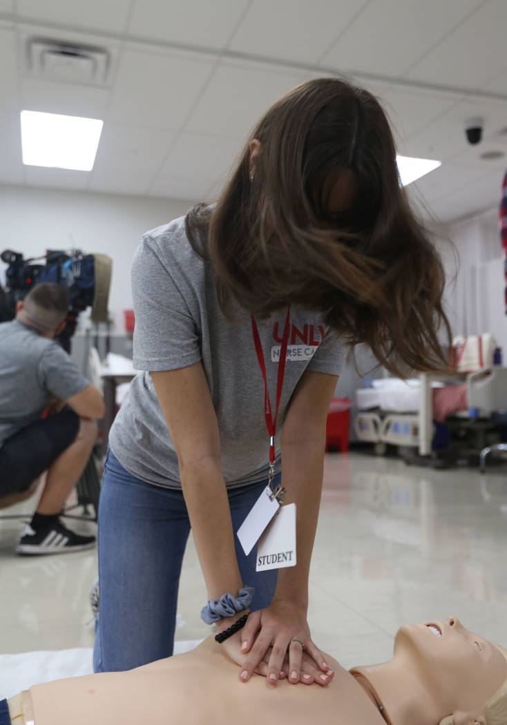 Mallory Gonzales, 17, practices breathing on a medical doll on Thursday, July 18, 2019 in Las V ...