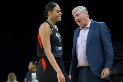 Las Vegas Aces head coach Bill Laimbeer, right, shares a laugh with Las Vegas Aces center Liz C ...