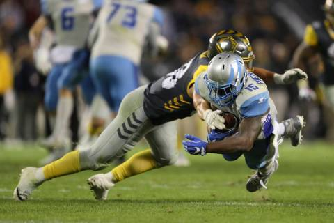 Salt Lake Stallions' De'Mornay Pierson-El (15) dives for extra yardage past San Diego Fleet l ...
