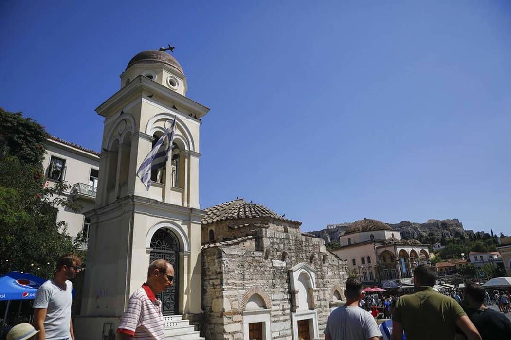 The bell tower of Pantanassa church at the Monastiraki square is damaged following an earthquak ...