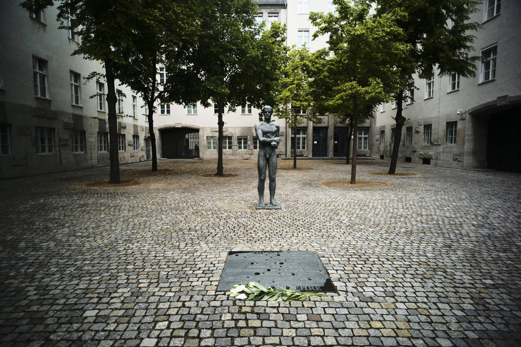In this Friday, July 12, 2019 photo a sculpture and a remembrance plaque placed in the courtyar ...
