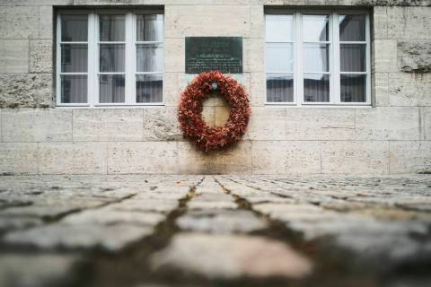 In this Friday, July 12, 2019 photo a wreath fixed under a remembrance plaque marking the place ...