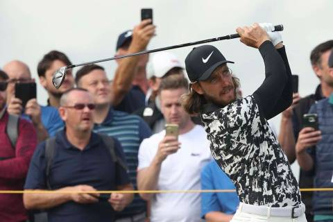England's Tommy Fleetwood plays his tee shot on the 9th hole during the second round of the Bri ...