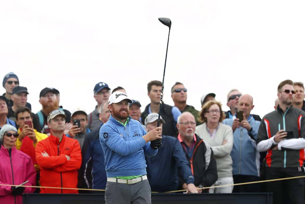 J.B. Holmes of the United States lines up his tee shot on the 14th during the second round of t ...