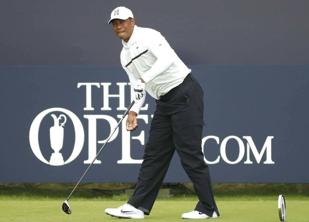Tiger Woods of the United States watches his ball after playing off the 1st tee during the seco ...