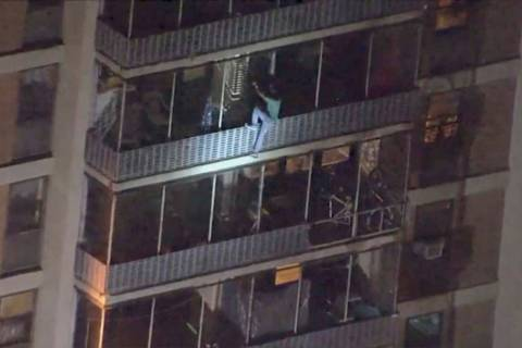 This image taken from video provided by WPVI-TV shows a man scaling down the side of a 19-story ...