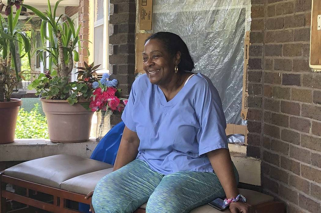 Deloris Knight of Detroit, Mich., sits on her front porch, Wednesday, July 17, 2019, as she pre ...
