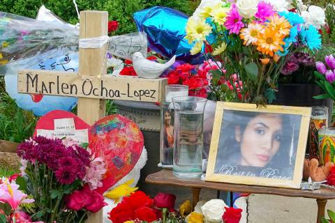 A memorial of flowers, balloons, a cross and photo of victim Marlen Ochoa-Lopez, are displayed ...