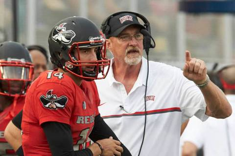 Kurt Palandech and UNLV offensive coordinator Barney Cotton during a game against Wyoming at Sa ...
