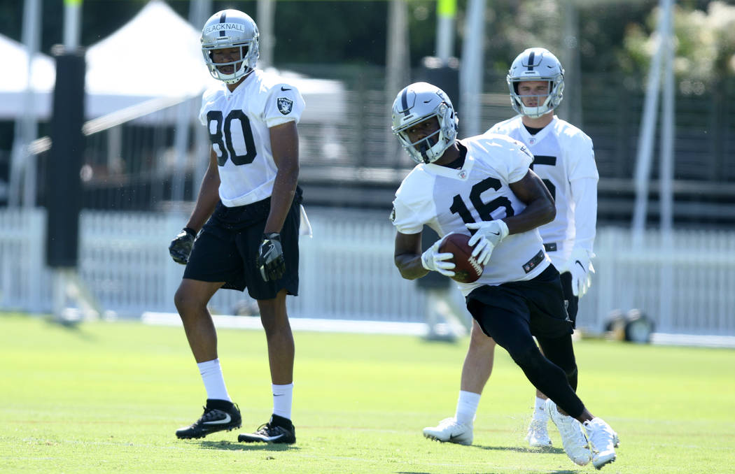 Oakland Raiders wide receiver Johnny Holton (16) runs with the football as wide receivers Saeed ...