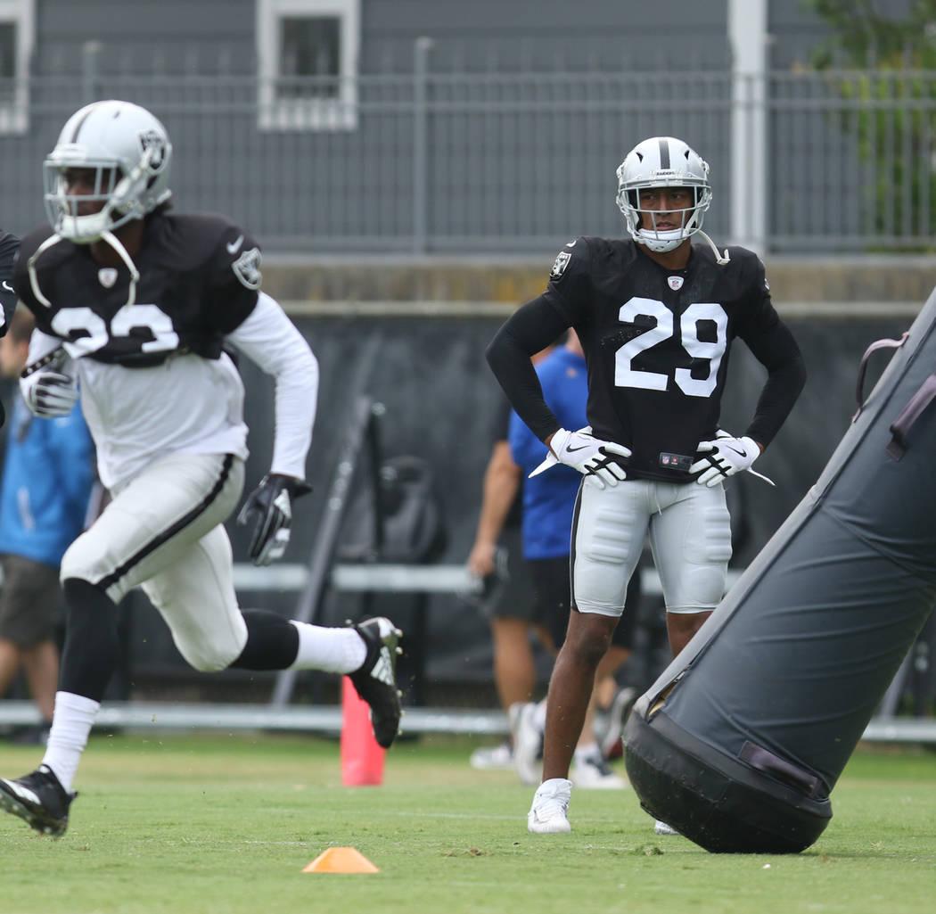 Oakland Raiders defensive back Leon Hall (29) watches cornerback Dexter McDonald (23) run throu ...