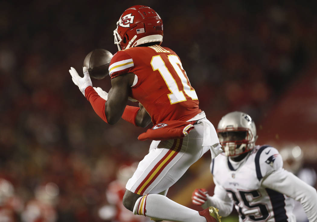 Kansas City Chiefs wide receiver Tyreek Hill (10) makes a catch during the first half of the AF ...