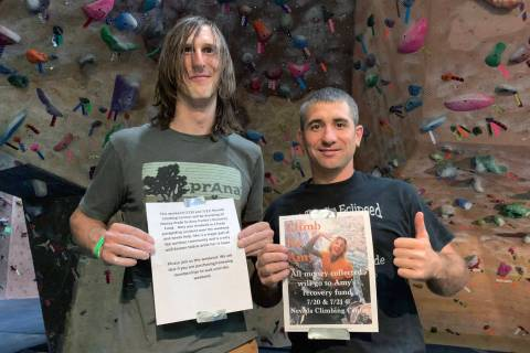Nevada Climbing Center manager Ryan Lawrence, left, and volunteer Dave Campbell, right, hold up ...