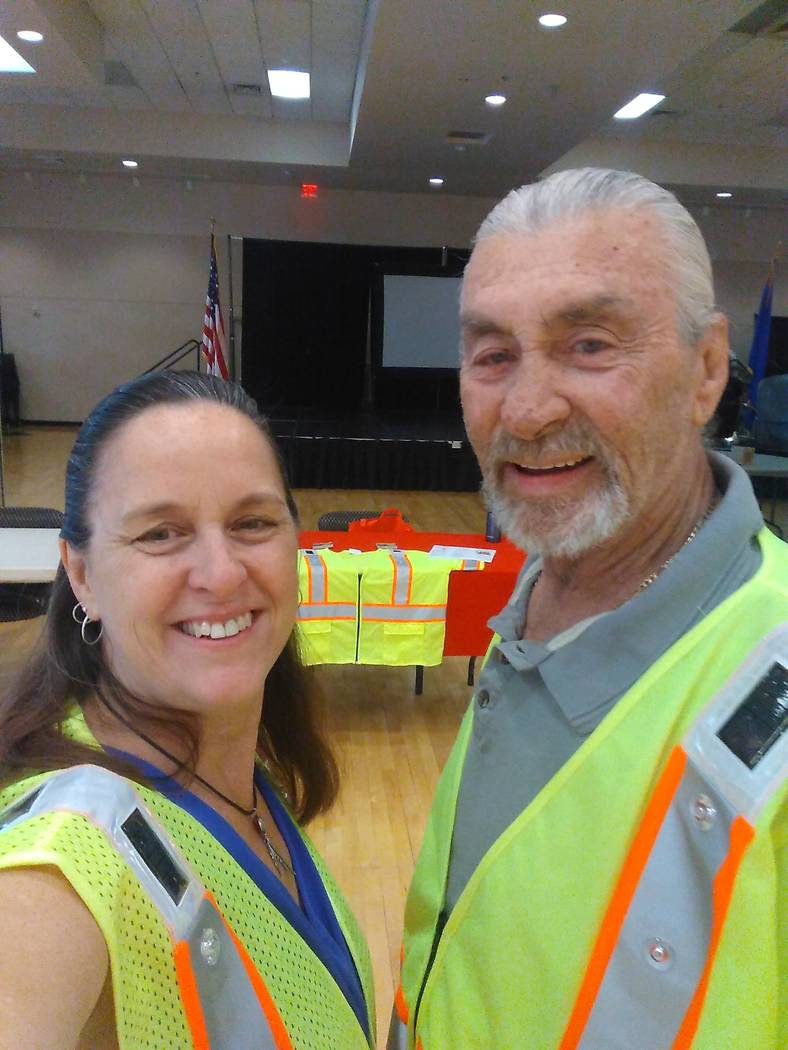 Megan Collins and Tom Mueller, founders of Solar LED Safety Products, are pictured wearing a sa ...
