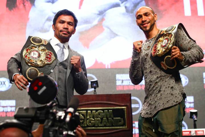 Manny Pacquiao, left, and Keith Thurman pose for pictures during a press conference ahead of th ...
