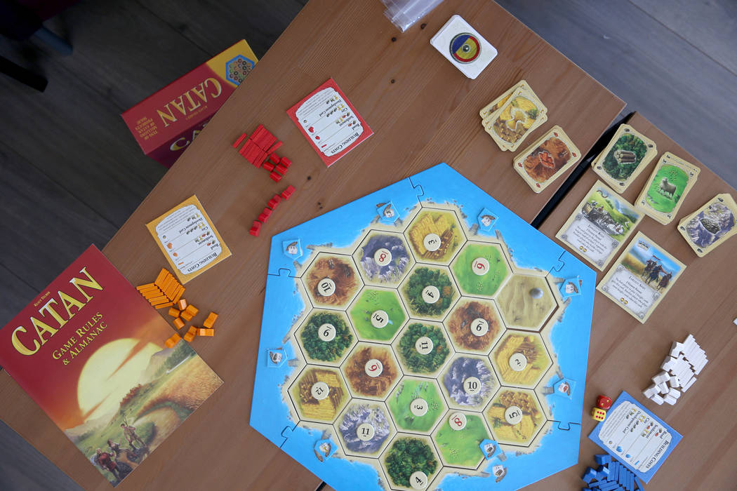 """The game """"Catan"""" at Boarding School Games in Las Vegas, owned by Emily Labejof and Ma ..."""