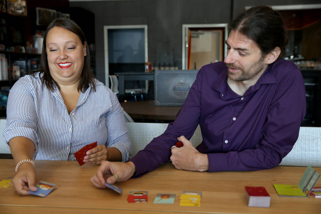 Emily Labejof and Matt Smiciklas, co-owners of Boarding School Games, demonstrate the game Sush ...