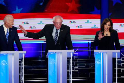 Democratic presidential candidate Sen. Bernie Sanders, I-Vt., center, and Sen. Kamala Harris, D ...