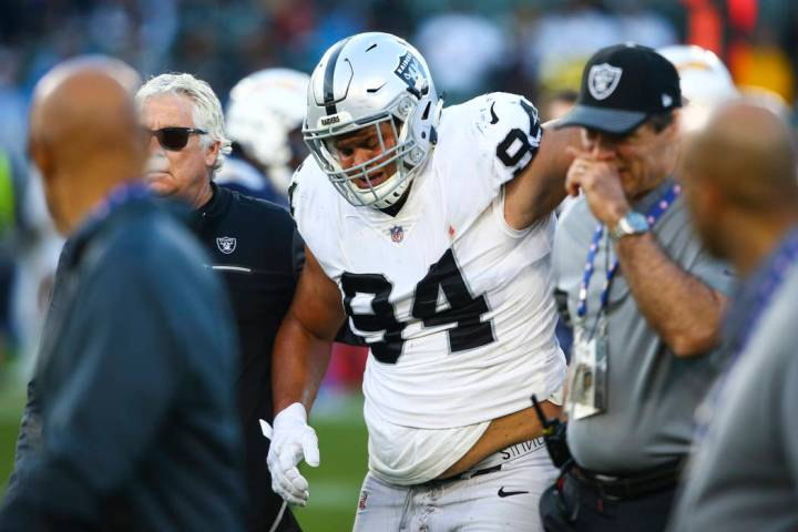 Oakland Raiders defensive tackle Eddie Vanderdoes (94) walks off the field after a torn ACL dur ...