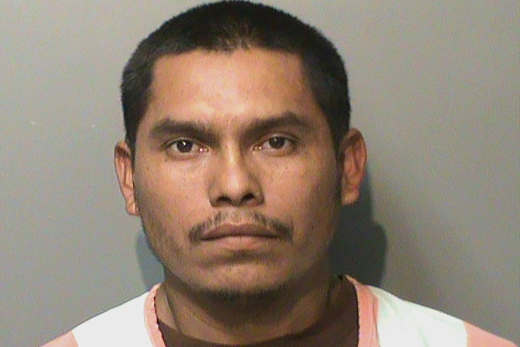 This booking photo released by the Polk County, Iowa, Jail, shows Marvin Oswaldo Escobar-Orella ...